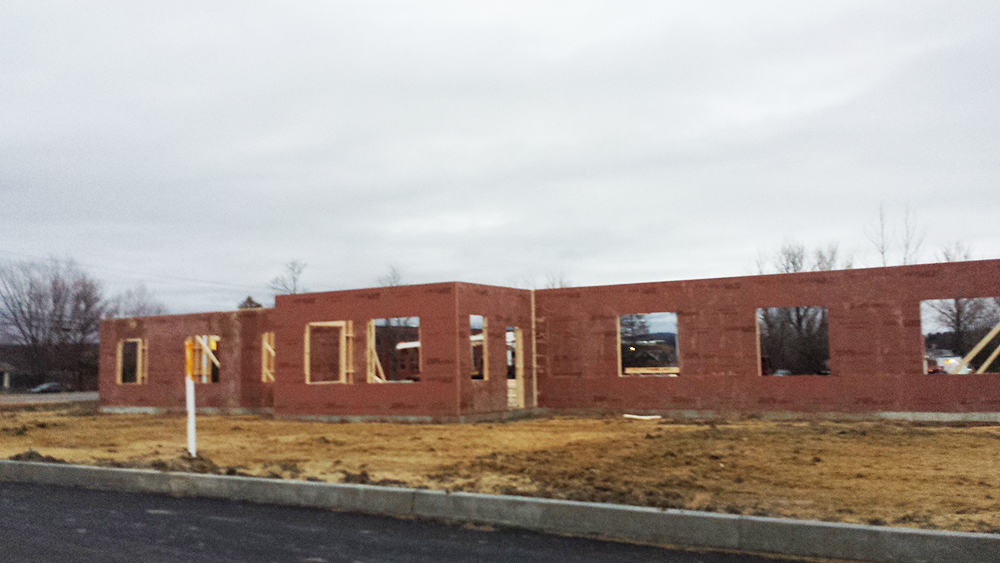 Walls starting to come together on our new building.